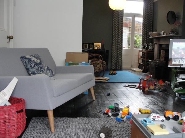 toy strewn living room